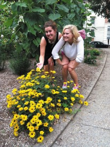 Gina and Maria take time to stop and admire the flowers as they have a sisters' moment.