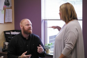 Chris talks with a co-worker at the Brighton Recovery Center.