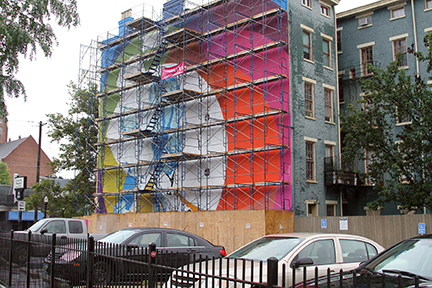 The James Brown mural takes shape as colors are added.