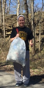 Hannah in action collecting bags of  aluminum cans.