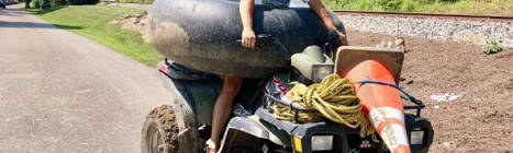 Erin Carrus with some trash found during River Sweep