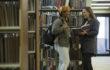 Women talking in library