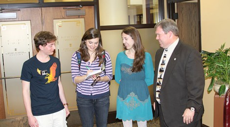 Tony Otten, Laura Barfield and Courtney Smalley present an original signed copy of Words to President Dave Armstrong.