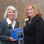 Cathy Silvers presents Melisa AlJamal with the  2014 Outstanding Women of Northern Kentucky Scholarship Award