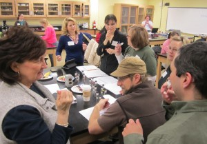 High school teachers having fun testing each other on identifying plant-derived scents with Dr. Bill Wetzel (Thomas More College, Chemistry), seen lower right.