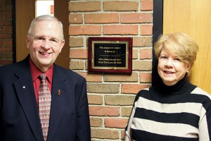 Two class of '64 reunion committee members, Deacon Jerry Franzen and Elaine Kohlhepp pictured with the newly installed classroom plaque.