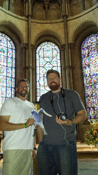 Former president of the TMC Alumni Association, Wayne Wycoff '97, and fellow alumni Devan Tucker '98 visit Canterbury Cathedral in Canterbury, England with Flat Tommy.