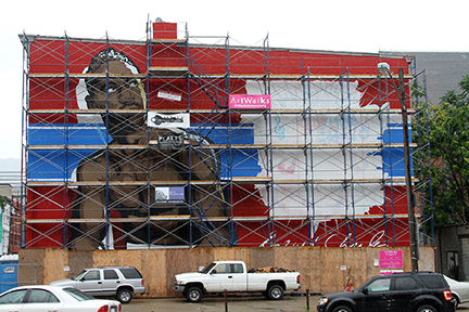 The Ezzard Charles is larger than life in the mural Jacob Condon is working on.