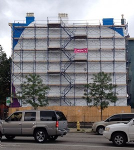 Scaffolding on the five story building that Chris Beiting will help transform this summer.