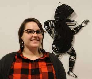"""Kate and one of her creations in the Eva G. Farris Art Gallery during her show """"Notes on Habitivity Appendix."""""""