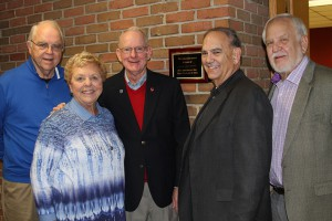 Pictured are five of the seven Class of 1965 reunion committee members along with the newly installed classroom plaque: Bill Van Lokeren (from left), Marie (Brue) Shields, Lou Esselman, Mick Goldberg, and Tony Zembrodt. Committee members not pictured are Jim Stautberg and Marlene (Geiman) Robinson.