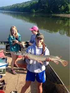 Tori Liles holds a large paddlefish caught while electrofishing with campers on the Ohio River.