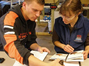 Mitchell Kriege conducts freshwater mussel research with laboratory manager Emily Imhoff.
