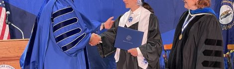 Chillo shaking hands with recent graduate