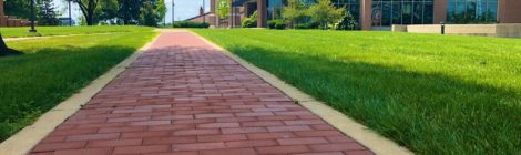 brick pathway leading to chapel
